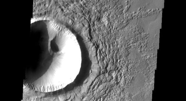 This image from NASA's Mars Odyssey shows a crater retaining some of the radial 'spoke' features on top of the main ejecta; some erosion has occurred and will continue to modify the surface until no surface features formed during emplacement are left.