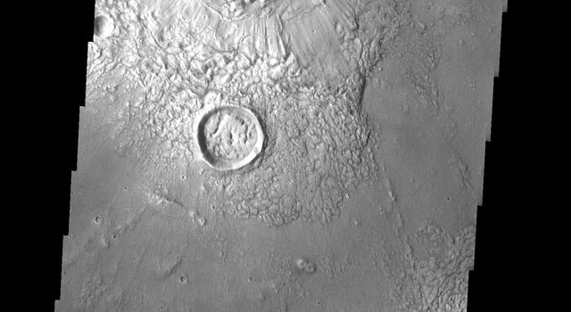 This image from NASA's Mars Odyssey shows a large crater on Mars retaining its original bowl shaped interior and the radial surface pattern on the ejecta. Just to the south is a crater that has been infilled by ejecta from the larger crater.