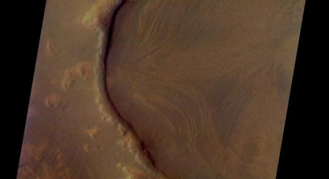 This is a NASA Mars Odyssey visible color image of an unnamed crater in western Arcadia Planitia. The crater shows a number of interesting internal and external features that suggest that it has undergone substantial modification since it formed.