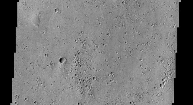In this NASA Mars Odyssey image of western Acidalia, two craters of similar size dramatically display the effects of geologic activity. The younger one on the left has been left relatively well preserved.