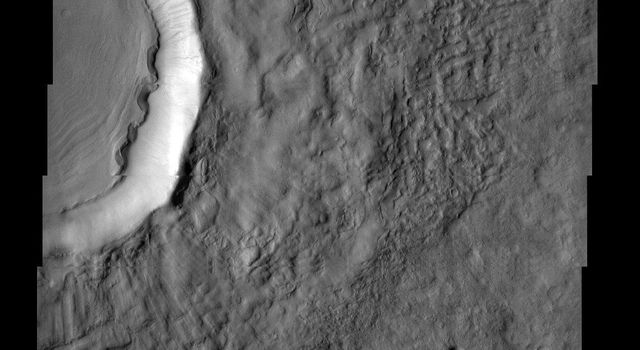 Freedom crater, located in Acidalia Planitia, exhibits a concentric ring pattern in its interior as seen in this image from NASA's Mars Odyssey spacecraft, suggesting that there has been some movement of these materials towards the center of the crater.