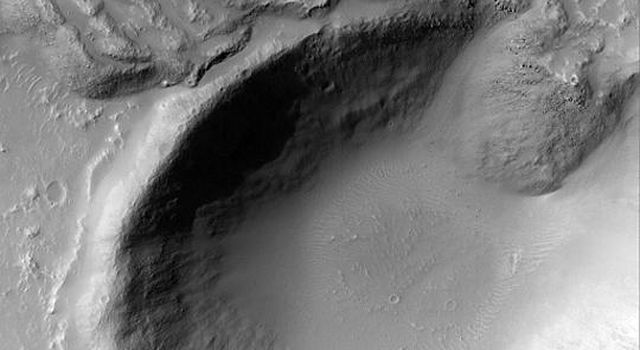 NASA's Mars Global Surveyor shows the margin of a large lava flow south of the Tharsis region of Mars.