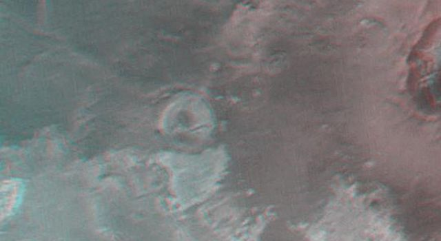 The light-toned materials at the bottom end of this anaglyph fomr NASA's Mars Global Surveyor are considered to be thick exposures of sedimentary rock. 3D glasses are necessary to view this image.