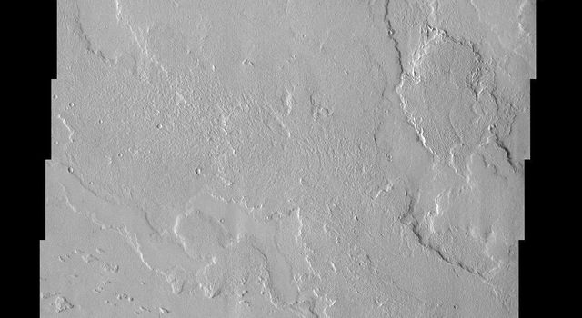 This image from NASA's Mars Odyssey spacecraft shows several lava flows in Lycus Sulci. Notice the streamlined features near the bottom of the image indicating the flow direction.