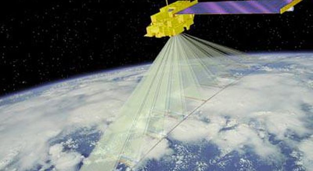 This artist concept is of NASA's MISR spacecraft which views the sunlit Earth simultaneously at nine widely spaced angles.