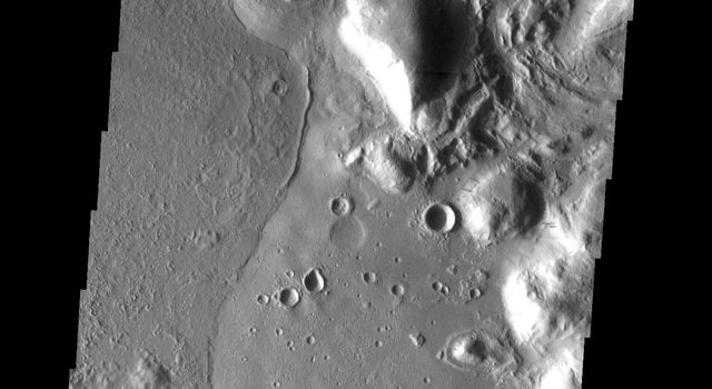 This image from NASA's Mars Odyssey observed variable surface textures on Mars, the result of different lava flow units.