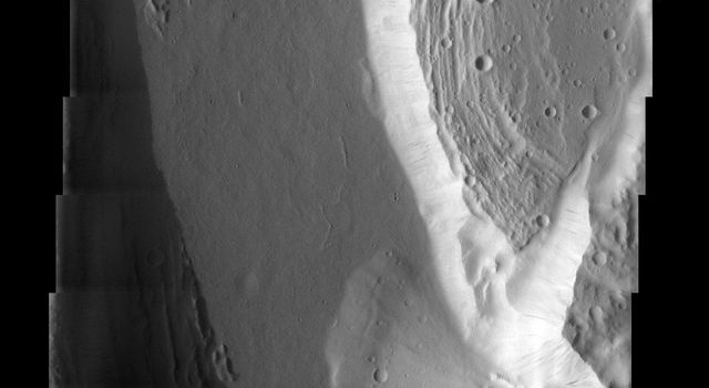 Just a small part of the huge Kasei Valles outflow channel on Mars is shown in this image captured by NASA's Mars Odyssey. Still, the awesome erosive power of the water that once flowed through this channel is evident.