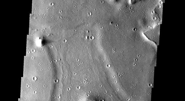 A channel-like feature roughly halfway between the Isidis Basin and Elysium Mons on Mars shows no connection to either a source region or terminal basin is seen in this image from NASA's Mars Odyssey.