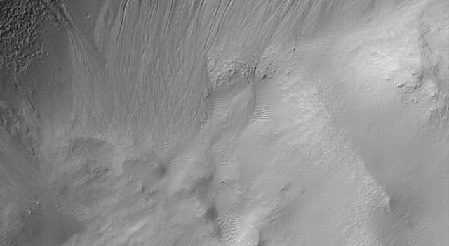NASA's Mars Global Surveyor shows gullies on the north wall of a crater in the Atlantis Chaos region on Mars.