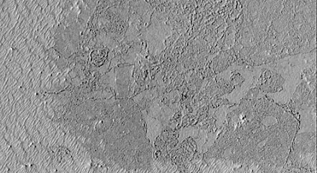 NASA's Mars Global Surveyor shows Cerberus and the Elysium volcanoes on Mars have a platy, textured surface thought to have formed by floods of thick mud or, more likely, very fluid lava.