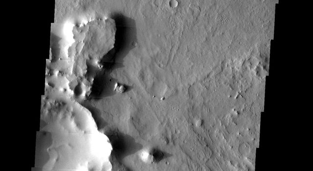 This image taken by NASA's 2001 Mars Odyssey shows two craters in Arabia Terra on Mars, in the old cratered highlands, are surrounded by many small mesas.