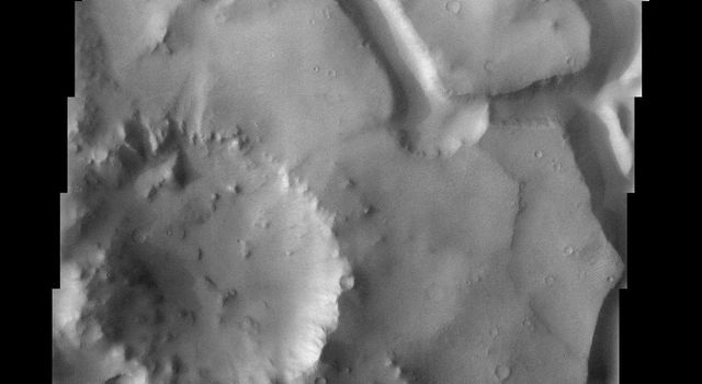 This image taken by NASA's 2001 Mars Odyssey shows chaotic terrain on Mars is thought to form when there is a sudden removal of subsurface water or ice, causing the surface material to slump and break into blocks.