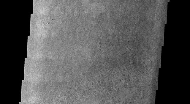This image taken by NASA's 2001 Mars Odyssey shows platy surface texture of the vast plains southeast of the volcano Elysium Mons on Mars likely formed by very fluid cooling lava.