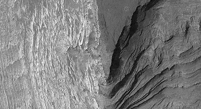 NASA's Mars Global Surveyor shows Terby Crater, a basin just north of Hellas Planitia on Mars. Sedimentary rocks are eroded and exposed.
