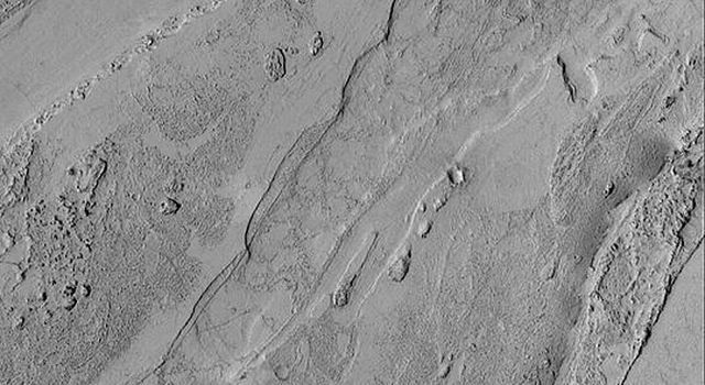 NASA's Mars Global Surveyor shows a portion of a shallow valley south of Cerberus on Mars. The valley may have been cut but torrents of mud-laden water; alternatively, an extremely fluid lava was involved.