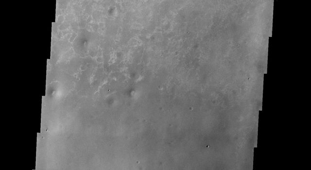 NASA's Mars Odyssey spacecraft captured this image in July 2003 of Meridiani Planum on Mars, which contains a mineral called hematite, usually forming in the presence of water.