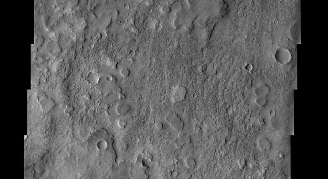 NASA's Mars Odyssey spacecraft captured this image in July 2003, showing a crater named after Dutch astronomer Christian Huygens (1629-1695) with an unusual texture. Smooth-topped mesas are scattered across a more rugged surface.