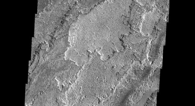 NASA's Mars Odyssey spacecraft captured this image in July 2003, showing remarkable differences in brightness and texture are apparent between these lava flows found on the southern flanks of Arsia Mons on Mars.