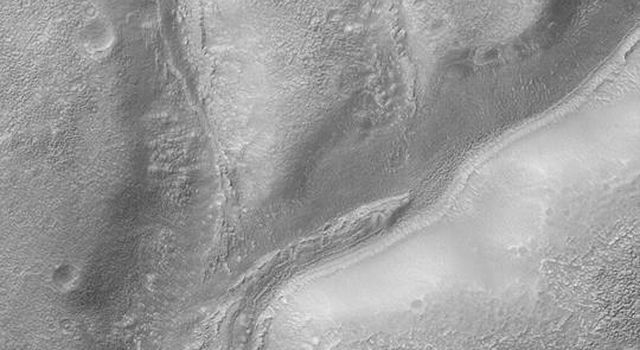 NASA's Mars Global Surveyor shows Warrego Valles, a suite of branching valleys located in the martian southern hemisphere.