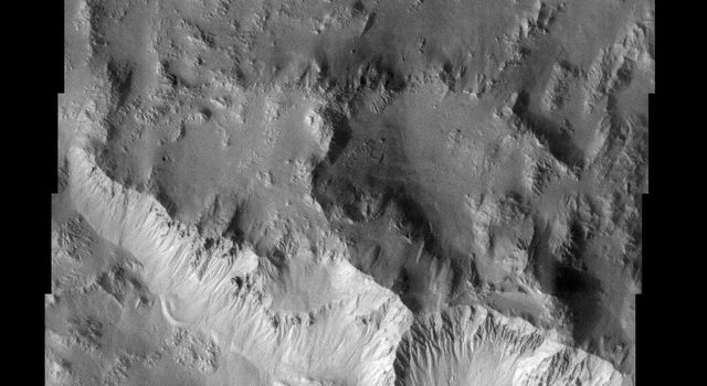 NASA's Mars Odyssey spacecraft captured this image in Sept 2003, showing the northern rim of Hale Crater on Mars, located in Noachis Terra, heavily dissected by the enigmatic gullies whose origin has been attributed to snow melt, ground water discharge.