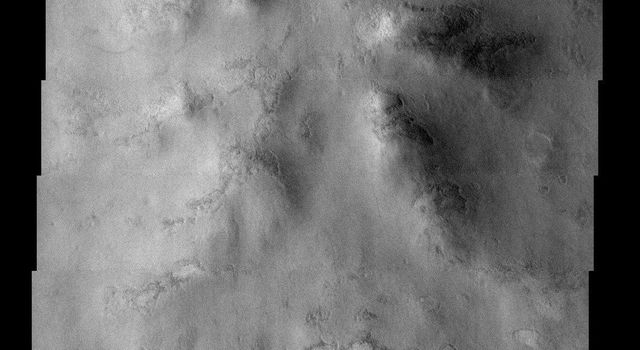 NASA's Mars Odyssey spacecraft captured this image in September 2003, showing degraded remains of a crater on Mars. This type of surface material is thought to be a mixture of dust and ice.