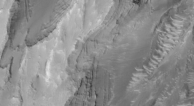 NASA's Mars Global Surveyor shows some of the layered, sedimentary rock outcrops exposed on a mound in Gale Crater on Mars.