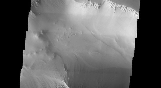 NASA's Mars Odyssey spacecraft captured this image in September 2003, showing the westernmost end of the enormous Valles Marineris canyon system on Mars wherein lies the ruptured landscape known as Noctis Labyrinthus.