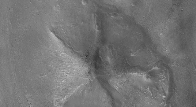 This image from NASA's Mars Global Surveyor highlights a Cydonia landform popularly known as the 'D&M Pyramid' on Mars. Much of the landform is covered with eroded mantling material.