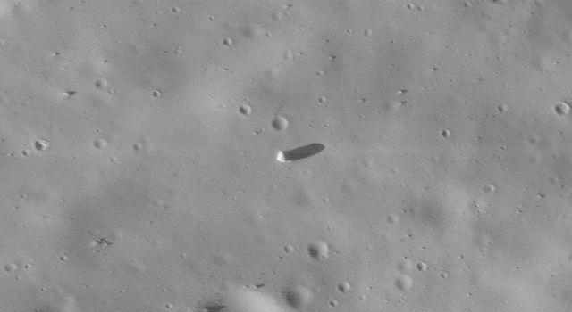 NASA's Mars Global Surveyor highlights the surface of Mars' moon, Phobos. Several large boulders are present. Most of the boulders may have been ejected from the largest impact crater on Phobos, Stickney.