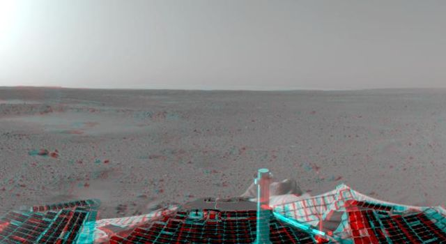 This sprawling look at the martian landscape surrounding the Mars Exploration Rover Spirit is the first 3-D stereo image from the rover's navigation camera. 'Sleepy Hollow' can be seen to center left of the image. 3D glasses are necessary.