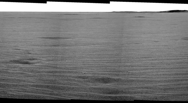 This mosaic image from NASA's Mars Exploration Rover Opportunity's panoramic camera provides an overview of the rover's drive direction toward 'Endurance Crater,' which is in the upper right corner of image.