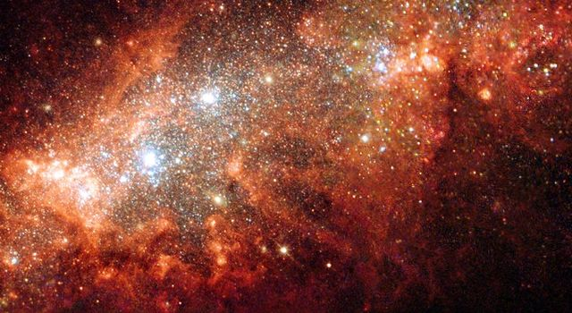 The nearby dwarf galaxy NGC 1569 is a hotbed of vigorous star birth activity, which blows huge bubbles that riddle the galaxy's main body. The image was taken by the WPF2 camera, designed and built by JPL, on NASA's Hubble.