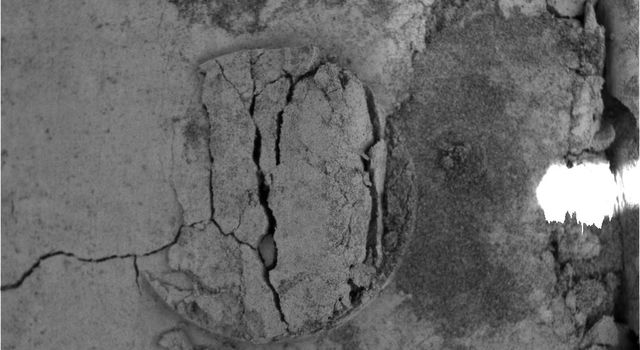 NASA's Mars Exploration Rover Opportunity shows the imprint of the donut-shaped plate on the rover's Moessbauer spectrometer instrument, located on rover's the 'arm.' The rover was investigating fine-grained soil for iron-bearing minerals.