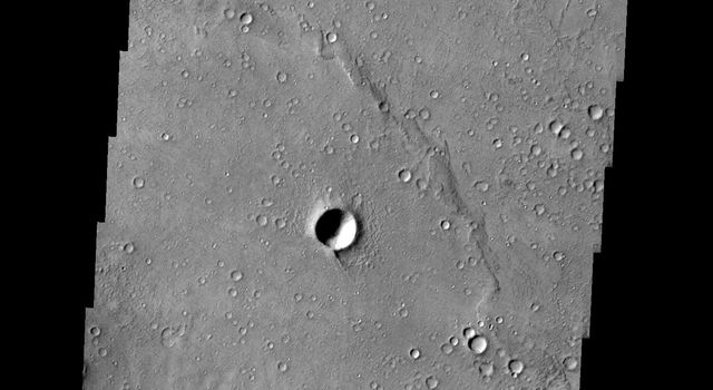 This image from NASA's 2001 Mars Odyssey released on Jan 14, 2004 shows the south-central area of Gusev crater on Mars, the landing site of Mars Exploration Rover Spirit.