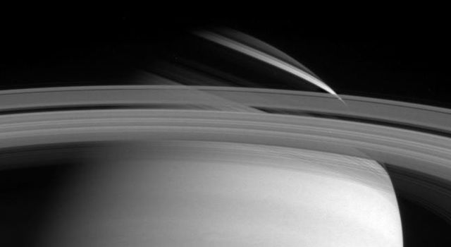 Saturn's rings cast threadlike shadows on the planet's northern hemisphere. Note the translucent C ring, and thin outermost F ring. The image was taken with NASA's Cassini narrow angle camera in visible light on May 10, 2004.