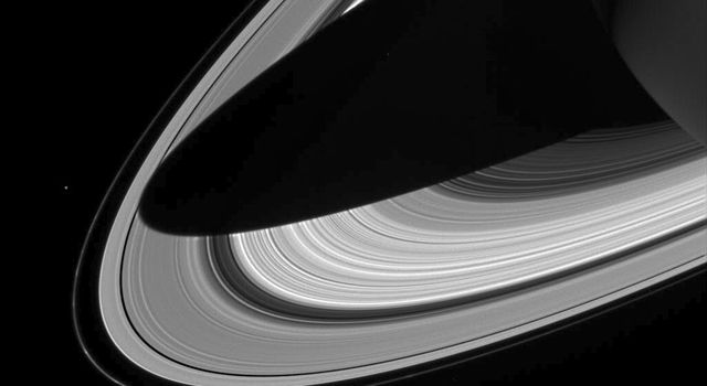 This image captured by NASA's Cassini spacecraft shows a dramatic view of Saturn's rings draped by the shadow of Saturn.
