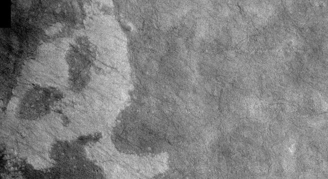 This image, part of an images as art series from NASA's 2001 Mars Odyssey released on Feb 23, 2004 shows the martian surface resembling a ghostly head, or rabbit.