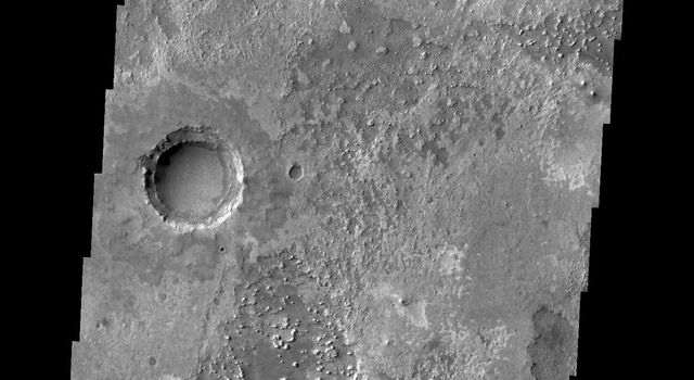 This image from NASA's 2001 Mars Odyssey released on March 16, 2004 shows three craters on Mars representing possibly three different ages of creaters, the youngest being the crater in the lower left which contains dunes.