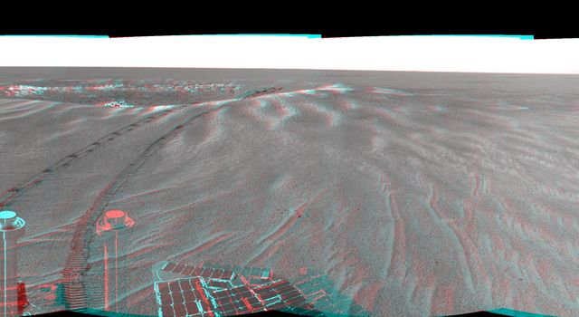 This is a 3-D version of the first 360-degree view from NASA's Mars Exploration Rover Opportunity's position outside 'Eagle Crater.' 3D glasses are necessary to view this image.