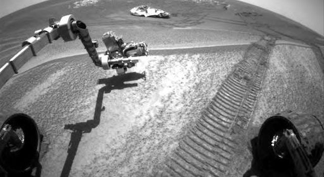 This image taken by the hazard-avoidance camera on NASA's Mars Exploration Rover Opportunity shows the rover investigating a bright patch of soil dubbed 'Mont Blanc' on Meridiani Planum.