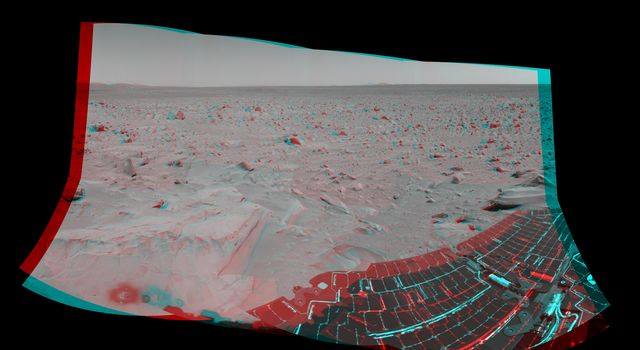 This 3-D cylindrical-perspective mosaic taken by the navigation camera on NASA's Mars Exploration Rover Spirit on sol 82 shows the view south of the large crater dubbed 'Bonneville.' 3D glasses are necessary to view this image.