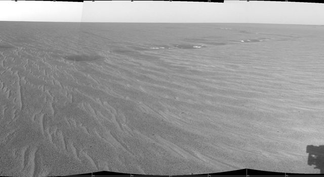 This image from NASA's Mars Exploration Rover Opportunity shows the rover's forward view at Meridiani Planum as well as 'Endurance Crater.' The shadow of the rover's panoramic camera mast assembly can be seen on the bottom right.