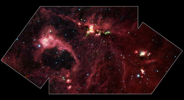 Hidden behind a shroud of dust in the constellation Cygnus is a stellar nursery called DR21 as seen by NASA's Spitzer Space Telescope.