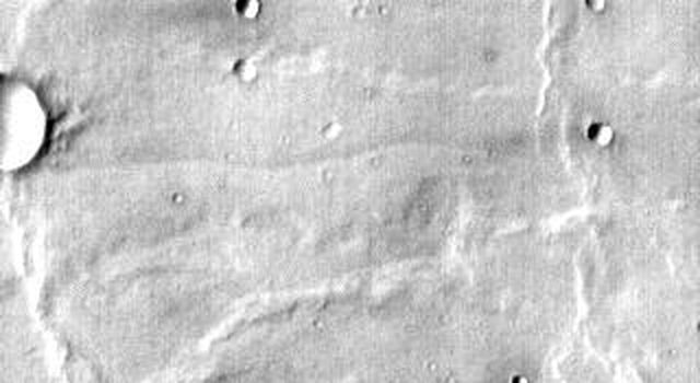 This image from NASA's 2001 Mars Odyssey released on April 8, 2004 shows old volcanic flows from Meroe Patera on Mars, recognizable only by the flow fronts (rounded lobes). Dust and erosion have covered or removed the rough lava surface.