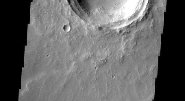 This image from NASA's 2001 Mars Odyssey released on April 20, 2004 shows a crater on Mars near Elysium Mons.