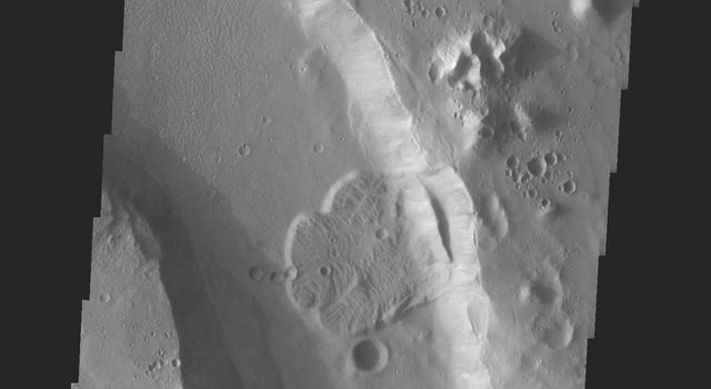 This image from NASA's 2001 Mars Odyssey released on April 26, 2004 shows a bend in the river in Tiu Vallis on Mars.