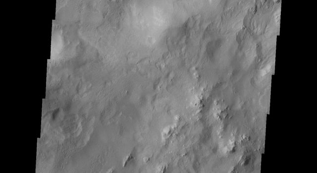 This image from NASA's 2001 Mars Odyssey released on April 29, 2004 shows crater walls on the martian surface at Hale Crater.