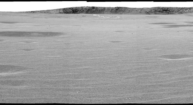 "This image mosaic from NASA's Mars Exploration Rover Opportunity's panoramic camera was taken from a rover position of the rim of ""Endurance Crater"" on Mars. Familiar ripples and dimples, common are seen on the plains of Meridiani Planum."