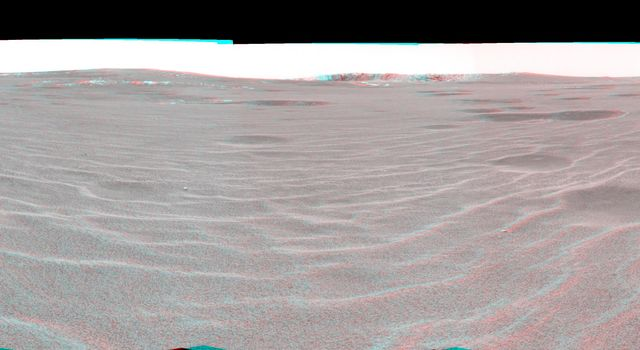 This 3-D cylindrical projection was taken by NASA's Mars Exploration Rover Opportunity on April 28, 2004. On that sol, Opportunity sat on the rippled dunes a ways from the rim of 'Endurance Crater.'