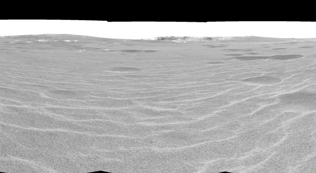 This cylindrical projection was taken by NASA's Mars Exploration Rover Opportunity on April 28, 2004. On that sol, Opportunity sat on the rippled dunes a ways from the rim of 'Endurance Crater.'